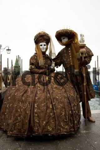 Two brown costumes and masks, Carnevale di Venezia, Carnival in Venice, Italy