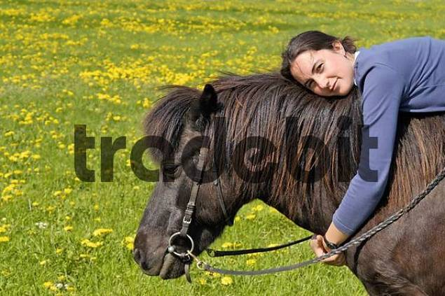 Young lady together and her Icelandic horse