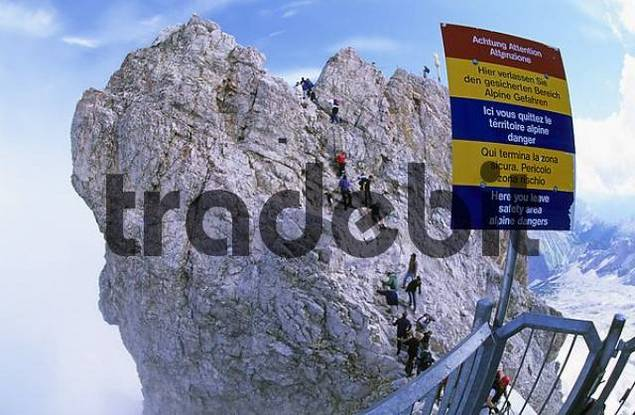 Tourists climbing the last few meters to the summit of the Zugspitze Germany