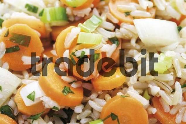 Vegetarian rice dish: carrots, leek and long-grain rice, image-filling