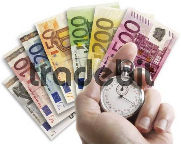 Hand holding stopwatch in front of Euro notes laid out in a fan - quottime is moneyquot
