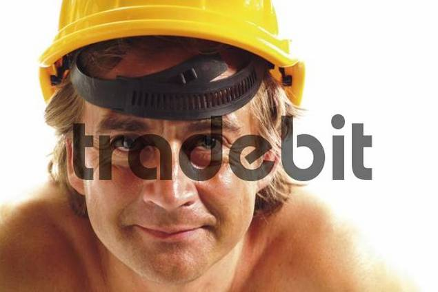 Shirtless construction worker wearing a construction helmet