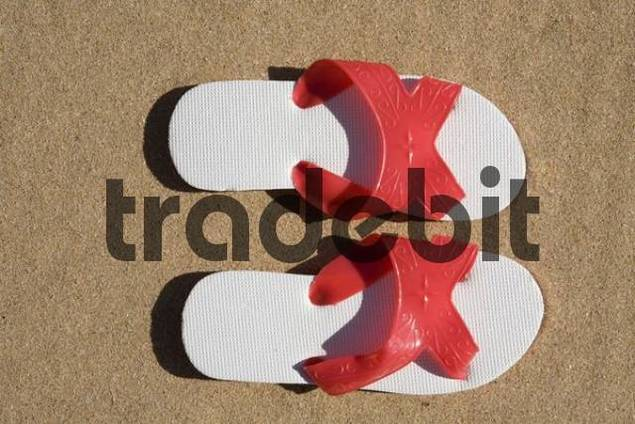Pair of sandals on the sand