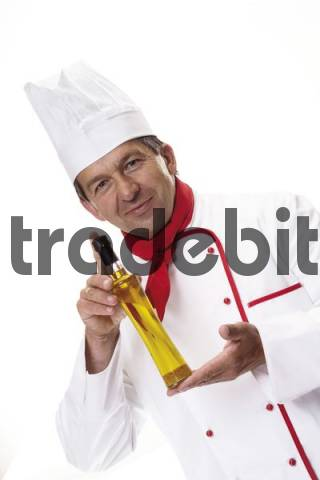 Chef displaying a bottle of olive oil