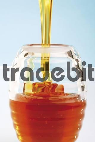 Honey poured into a glass
