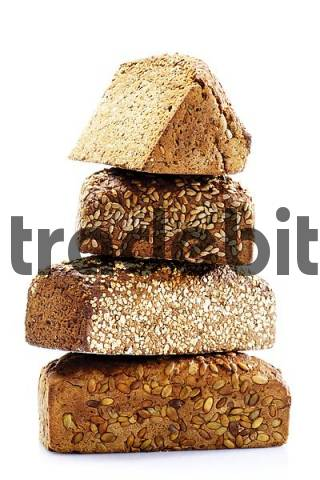 Four kinds of wholegrain bread, stacked