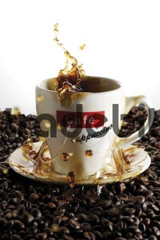Cup of coffee, splashing