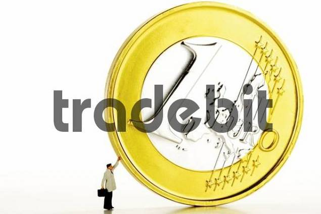 Man with briefcase propping up a 1-Euro coin