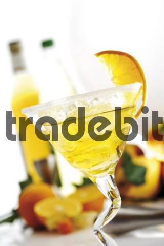 Cocktail: orange liqueur on ice, glass rimmed with sugar