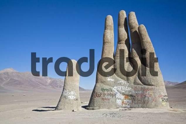 Mano del Desierto is a large-scale sculpture of a hand, Atacama Desert, Chile, South America