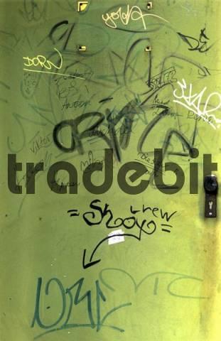 Graffiti on a green steel door