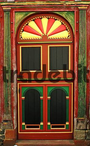 rich decorated and colorful painted entrance door of an historical building