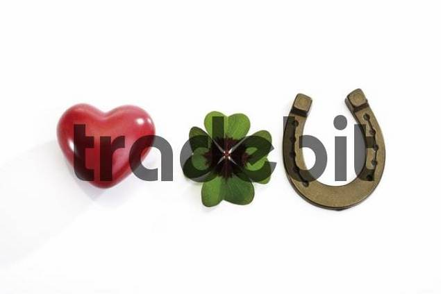 Horseshoe, four-leaf clover and a red heart