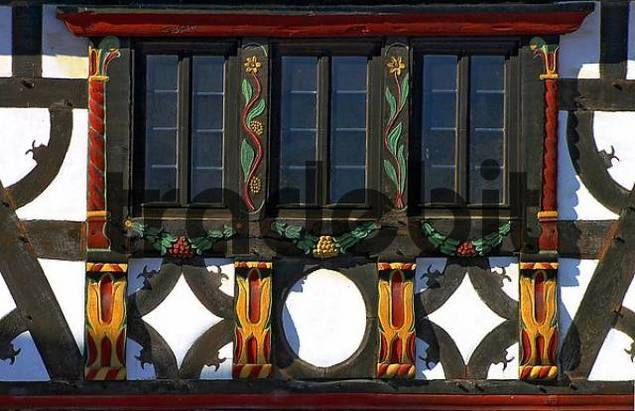 detail of a rich decorated and painted framework facade