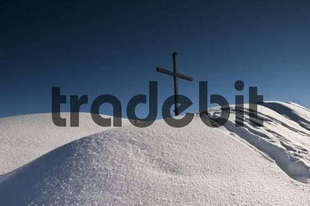 cross on the summit of Pendling, winter scenery, Kufstein, Tyrol, Austria