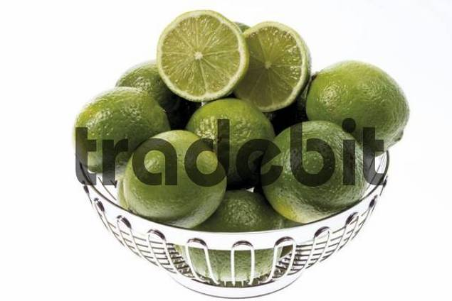 Limes in a chrome-plated fruit bowl