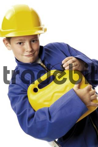 Young boy wearing hardhat holding a jerry can