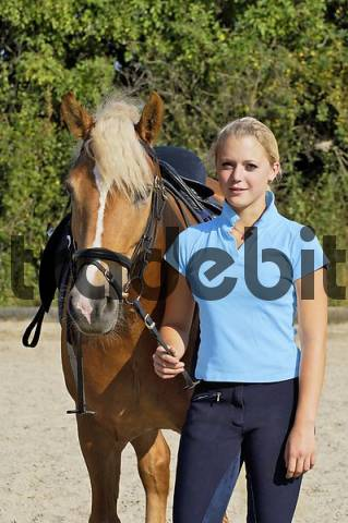 16 years old girl with Haflinger horse