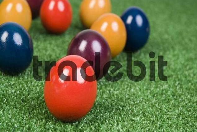 many coloured Easter eggs in meadow