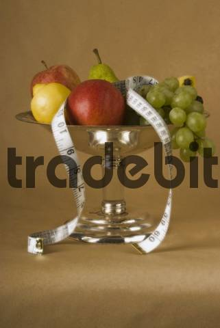 fruit basket with fruits and measuring tape