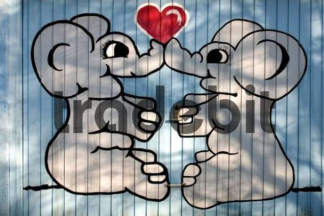 Elephants in love, painted on garage door