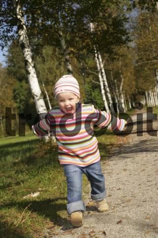 Three-year-old girl running