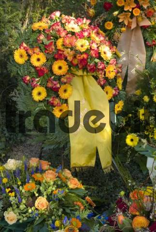 Fresh grave decorated with countless flowers at a cemetery in Germany