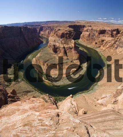 Two boats navigating the Horseshoe Bend river bend, Colorado River, Gooseneck near Page, Arizona, USA, North America