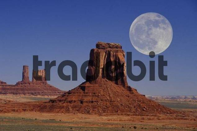 full moon above sandstone buttes in Monument Valley Arizona USA