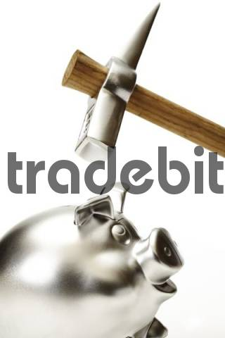 Silver piggy bank and hammer