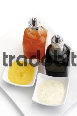 Small bowls of relish and cruet bottles
