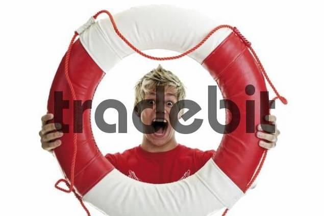 Young man screaming through lifesaver