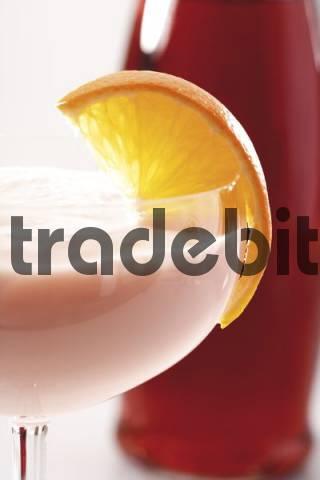 Campari orange cream liqueur garnished with an orange slice, section