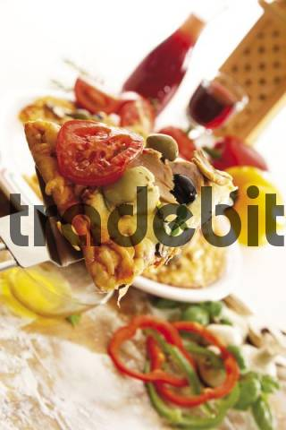 Slice of pizza with tuna, olives, mushrooms and tomatoes