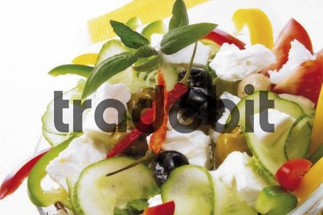 Greek specialty: feta, cucumbers, peppers, olives, dried chili peppers, sage leaves and garlic cloves