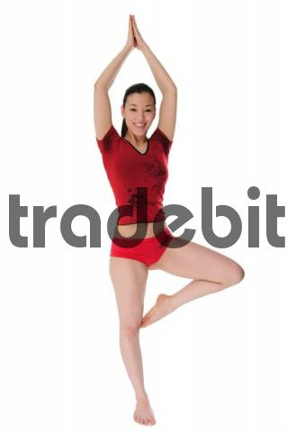 East Asian girl meditating, yoga position cutout