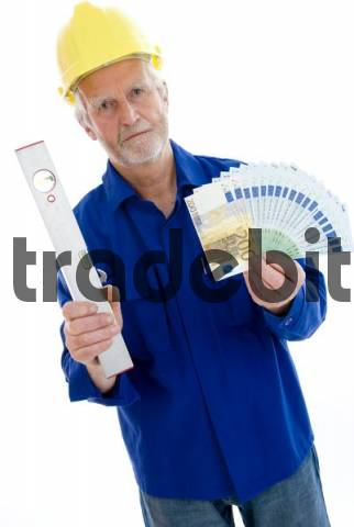 Older tradesman holding cash