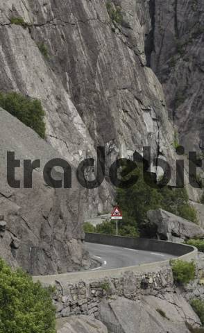 Road sign before a tunnel along a narrow, rocky highway, Vest-Agder, Norway, Scandinavia