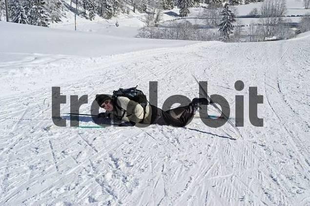 Fallen cross-country skier Valepp near Spitzingsee lake Spitzing Upper Bavaria Germany