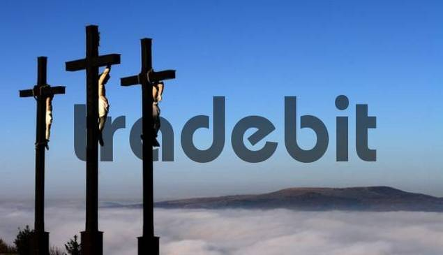 Three crucifixes over a blanket of mist, Kreuzberg, Rhoen Mountains, Bavaria, Germany