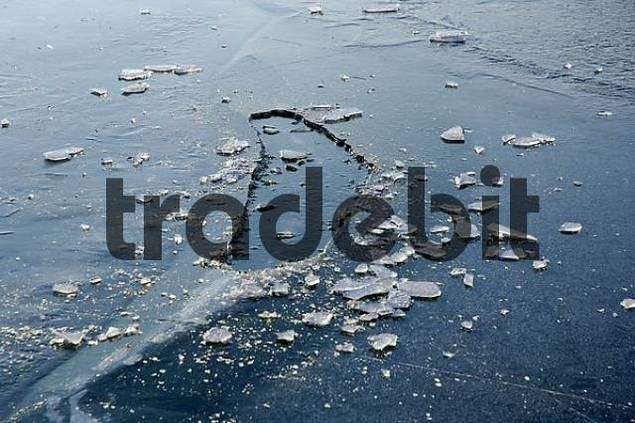 a frozen hole in a frozen ice on a lake