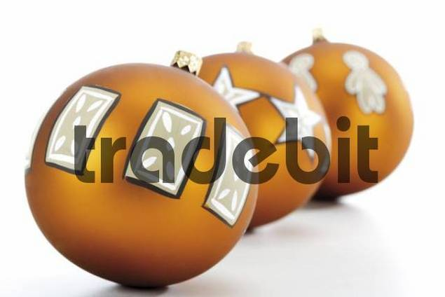 Three golden Christmas ornaments, balls in a row