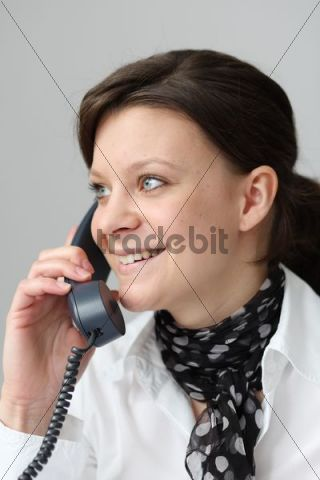 Young woman phoning in the office