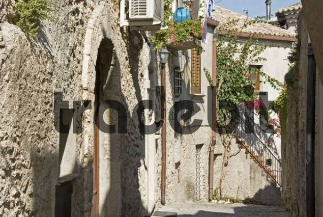 Narrow alley between old stone buildings in Gerace, Calabria, Southern Italy