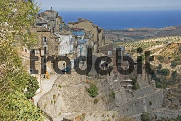 Mountain village built on very steep terraces, view of orchards and sea at back, Povalino, Calabria, Southern Italy