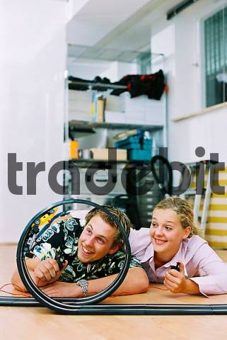 young couple playing car speedwaytoy cars speed car