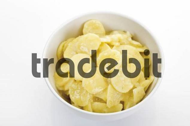 Bowl of potato salad with oil and vinegar dressing - Download Abstract