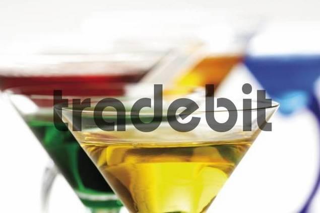 Several glasses of colourful liqueur