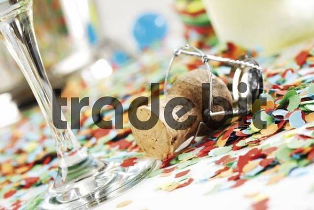 Champagne cork on confetti
