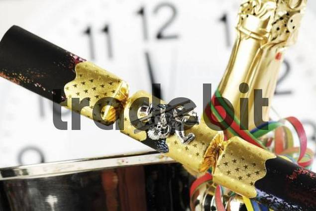 Firecrackers with chimney sweeper as a lucky charm, clock displaying 12 oclock, midnight